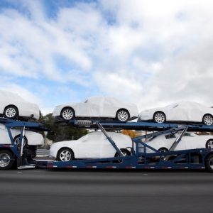 A Vehicle Transport Truck Carrying New Cars